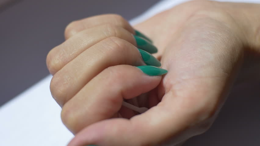 Woman shows a IUD birth control device on her palm.