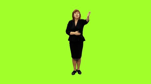 Elegant business coach in black dress speaks to the audience on green screen background, Chroma key, 4k pre-keyed footage