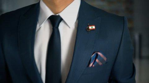 Businessman Walking Towards Camera With Country Flag Pin - Lebanon