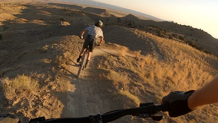 Thrilling POV, point-of-view of a mountain biker following another one on Joe's Ridge single track trail in Fruita, Colorado.  This network of trails is located on 18 Road in  the North Fruita Desert.