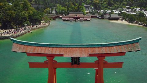 Aerial Drone dramatically flying away from Itsukushima Shrine at Miyajima, Hiroshima, Japan