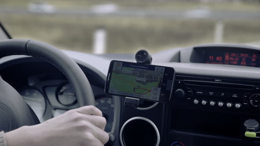 GPS navigation on smartphone showing route 4K. Close up on navigation screen tracking vehicle location and route while driving on road.