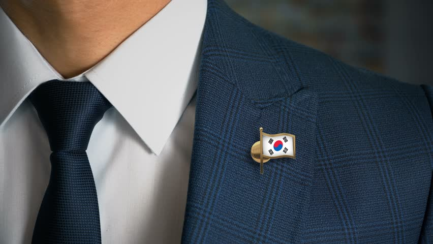 Businessman Walking Towards Camera With Country Flag Pin - South Korea | Shutterstock HD Video #1014407420