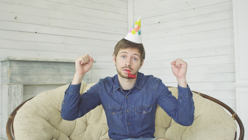 Unhappy bored birthday man with stubble feeling sad and disappointed because nobody came to celebrate his anniversary