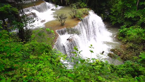 Beautiful waterfall in deep forest, Huay Mae Kamin Waterfall in Thailand, slow motion