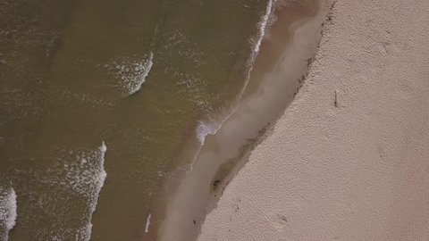 4k AERIAL: sandy Baltic Sea shore filmed from drone. Top view video. 3840x2160, 30fps, d-cinelike for color grading.