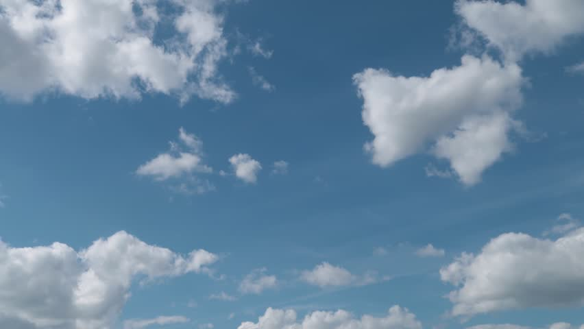 Big clouds on a blue sky | Shutterstock HD Video #1014474440