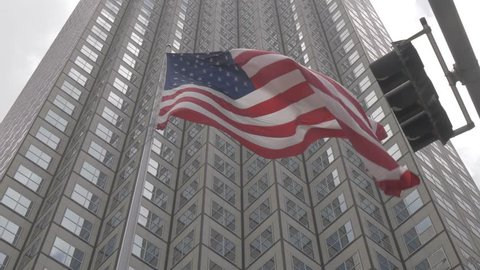 View of American flag set against skyscraper windows, Downtown, Miami, Florida, United States of America, North America