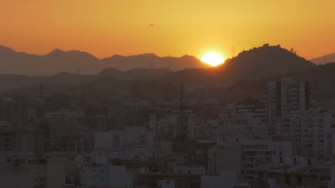 Elevated view of Malaga and surrounding Andalucian mountains at sunset, Malaga, Andalucia, Spain, Europe