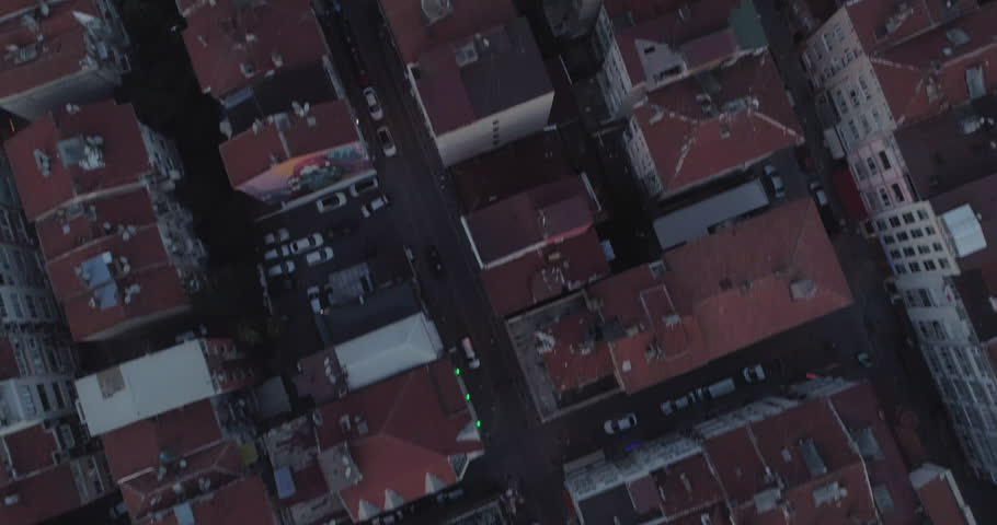 "A breathtaking 4k sunset aerial flight next to Bosphorus Bridge over the Istanbul neighbourhood rooftops of Otrakoy. Istanbul. Turkey. Ortakoy means ""middle village"" in Turkish"
