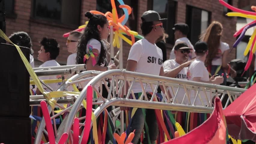 Medellin, Colombia - July 11, 2018: Gay community dancing in a truck during gay pride in Medellin