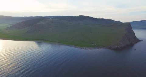 Green shore of Baikal lake from the bird's-eye view