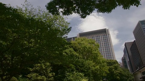 Skyscrapers among green trees in asian city