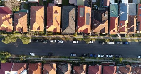 Developed streets and blocks of land with small properties and houses of residents in aerial top down view in Sydney's north shore.