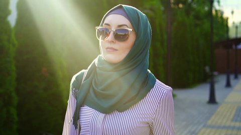 Portrait of a stylish muslim woman in hijab,sunflare.