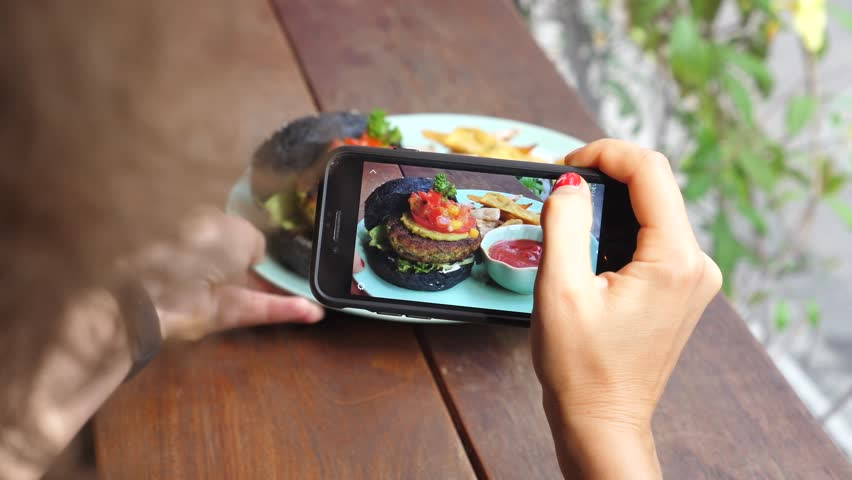 Woman Hand Taking Picture Of Burger With Smartphone | Shutterstock HD Video #1014597380