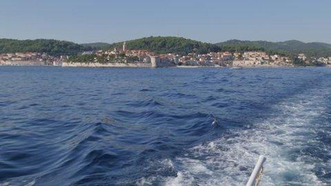 On boat in Luka Korculanska Bay leaving Korcula Old Town, Korcula, Dalmatia, Croatia, Europe