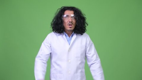 Crazy scientist wearing protective glasses and panicking