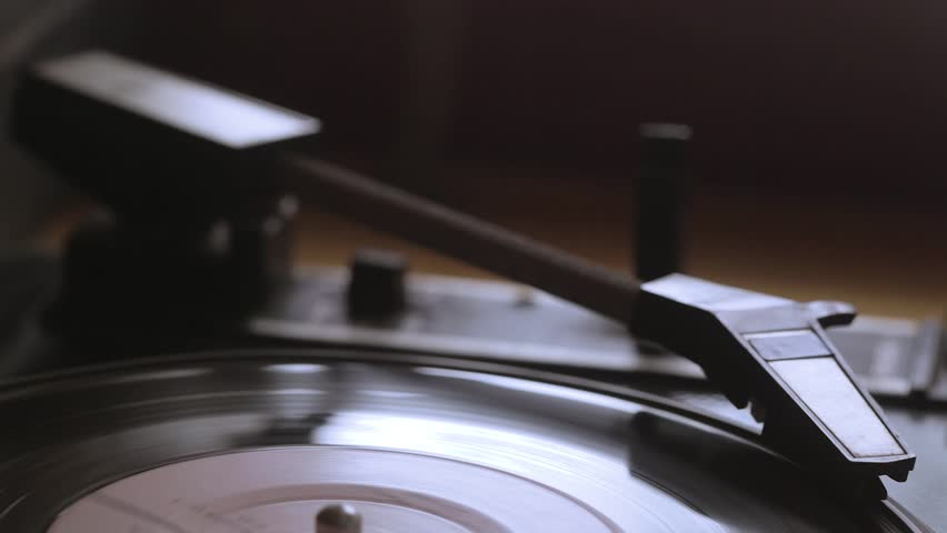 The old vintage gramophone reproduces the track. Close up view | Shutterstock HD Video #1014690170