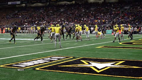SAN ANTONIO, TEXAS - JANUARY 06, 2018: Quarterback Trevor Lawrence gets sacked by Linebacker Raymond Scott in the US Army All American Bowl all star game.