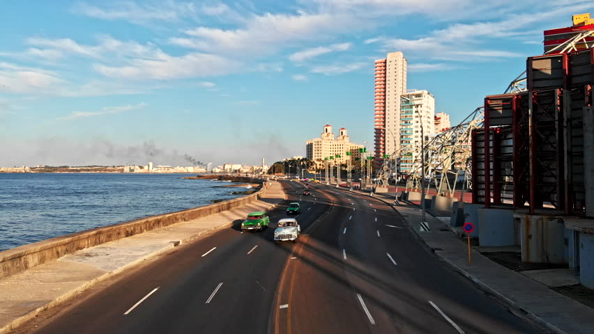 Cuba Havana v47 Low detail avenue view following path of Malecon looking toward canal 4/18 | Shutterstock HD Video #1014705620