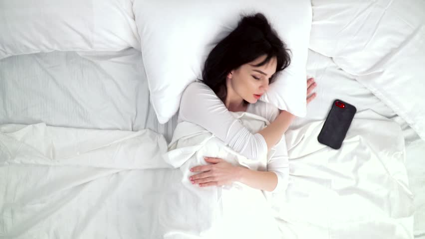 Morning Alarm. Beautiful Woman Waking Up From Alarm On Phone