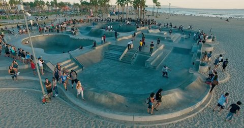 Drone flies under famous skate park in the Venice Beach, Los Angeles on sunset.