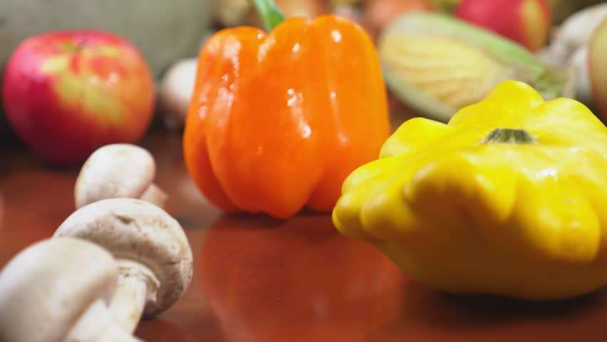 Autumnal Harvest or Thanksgiving, Cornucopia filled with vegetables, vegetables spilled out of the basket on the table. 4k, dolly shot