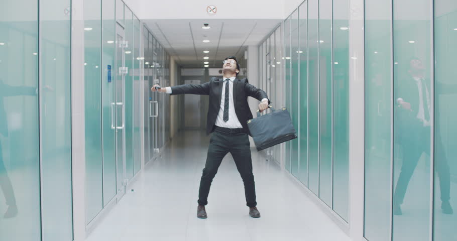 Young south asian businessman doing victory dance after promotion. busineessman happy after successful deal. business, victory concept 4k | Shutterstock HD Video #1014792530