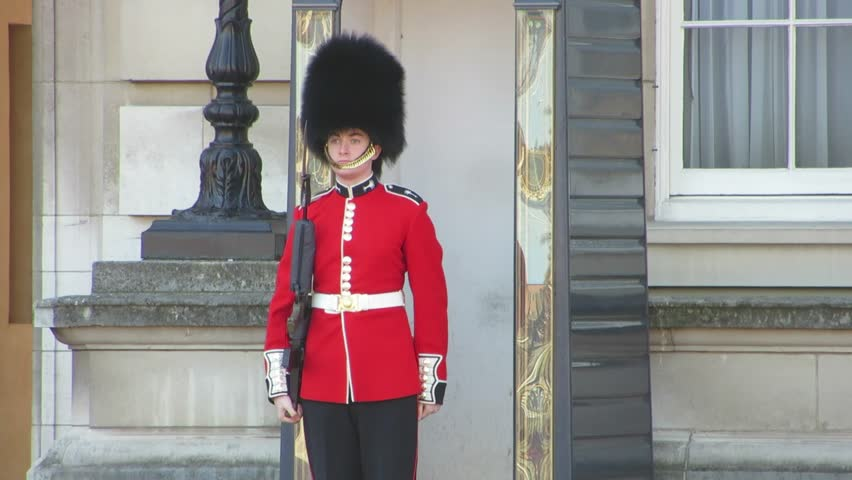 London / England / United Kingdom – April 2013: A Beefeater guard at a palace in London, England.
