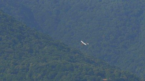 Floatplane landing on Lake Como in Italy