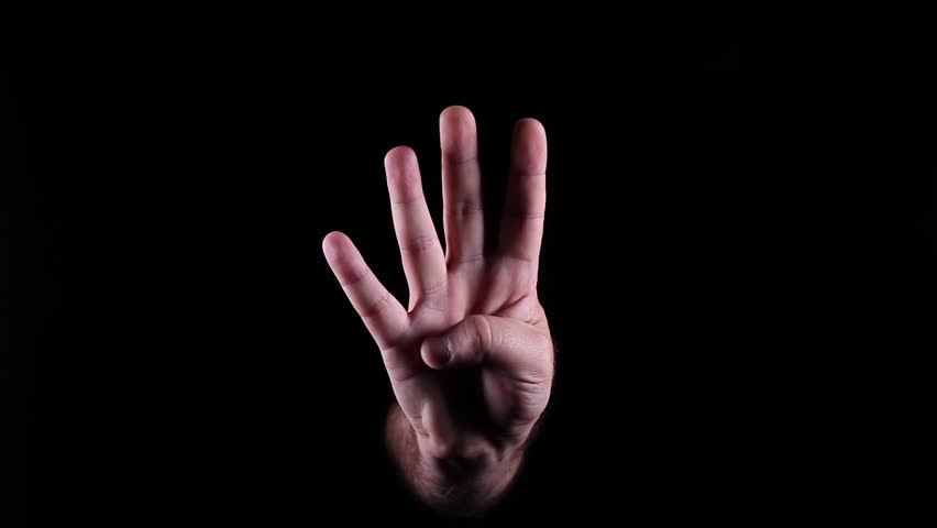 Hand Gestures coming out of the dark into the light. Holding GFX object vertically. The number 4.