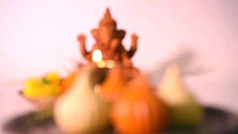 Ganesha or Ganpati idol with pooja thali and Modak food