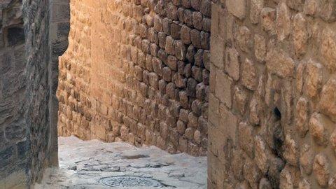 A little street between stone wall in Mardin