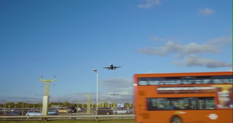 Commercial Airplane Landing at Heathrow International Airport.