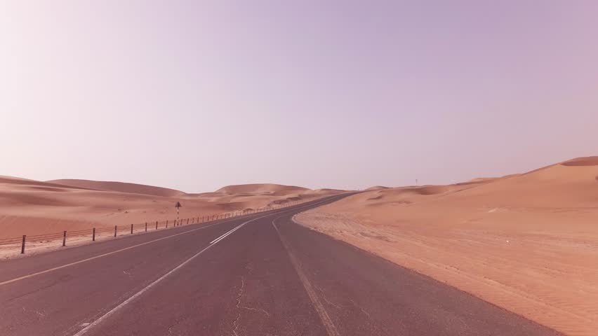 New road from Oasis Liwa to the Moreeb Dune in Rub al Khali desert stock footage video
