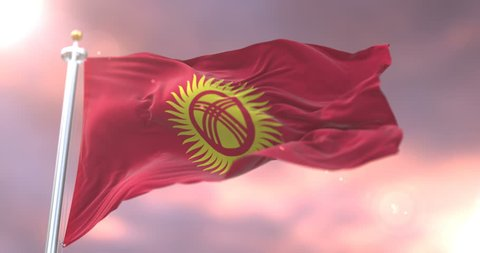 Flag of Kyrgyzstan waving at wind at sunset in slow, loop