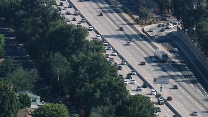 Aerial view of busy highway during the day. Shot of highway in Los Angeles, California. Shot with a RED camera. 4k footage.
