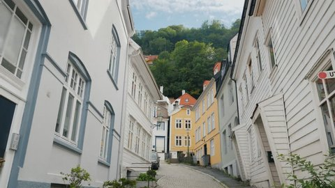 A narrow street with beautiful old wooden houses in Bergen, Norway