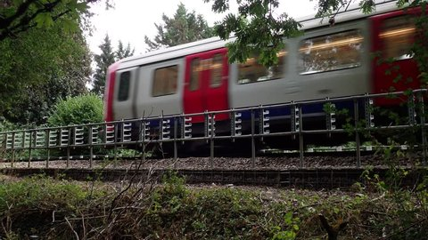 London Underground S8 train passing by on the Metropolitan line