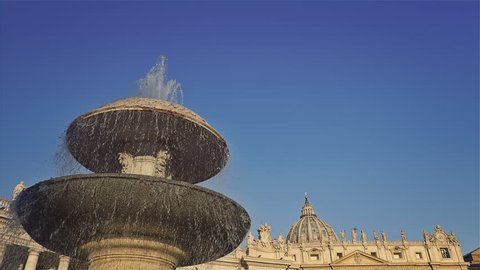 The famous Fountain of San Pietro Italian square with Saint Peter church columns, in Rome, Italy