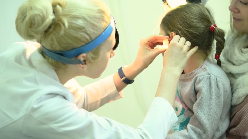 Ear, nose, throat examining. doctor with a child and endoscope. otolaryngology