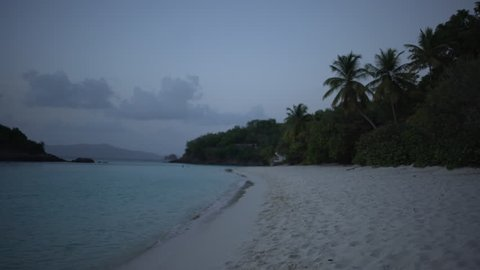 Twilight shot of the Caribbean shore for green screen or chroma key. Out of focus or defocused background plate.