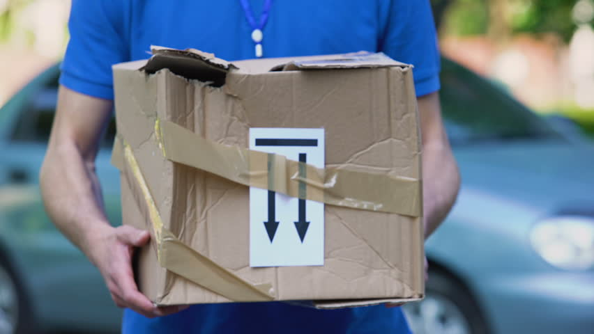 Frightened delivery worker giving broken customer parcel, shipment accident | Shutterstock HD Video #1015043230