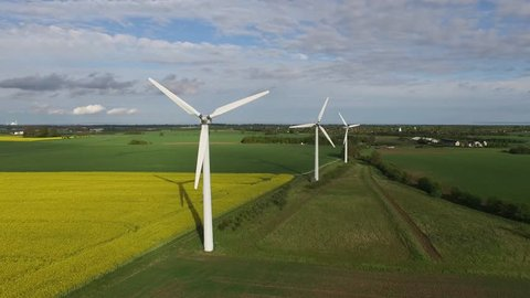 Aerial view of wind turbines and danish countryside