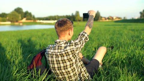 cute boys taking selfies