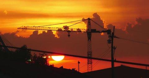 Crane silhouette against levees sunset