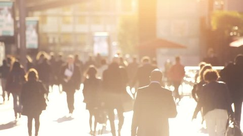 crowd of people walking on the street in abstract big city, back light, Europe