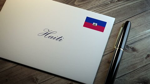 Country name written on a card or envelope in cursive font with a sleek pen on a wooden table surface under beautiful classy light. Stamp in the corner shows the flag of Haiti