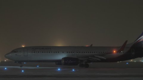 MOSCOW, RUSSIA - JANUARY 29, 2018: Aeroflot airplane Boeing 737-800 S. Eisenstein arrival at Sheremetyevo Airport at winter night. Aircraft taxiing on runway